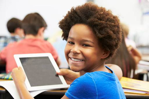 Smiling girl with tablet
