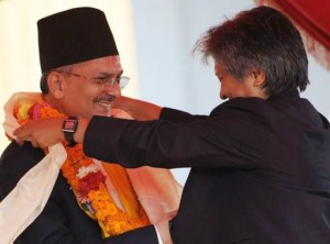 Prime Minister Dr. Baburam Bhattarai receives a congratulatory flower garland from his wife. Photo: Prakash Mathema, AFP