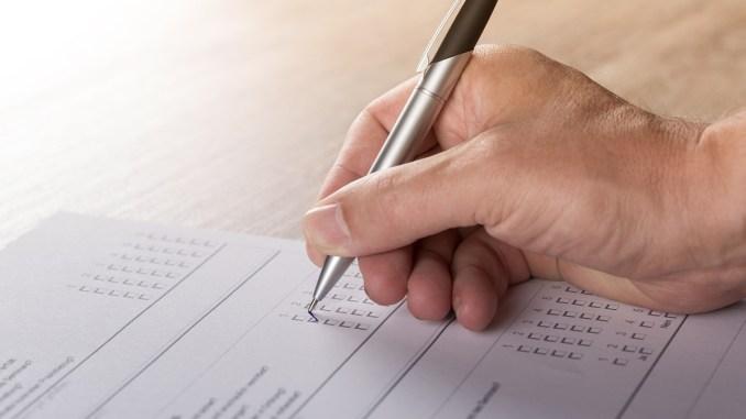 Hand recording written vote.