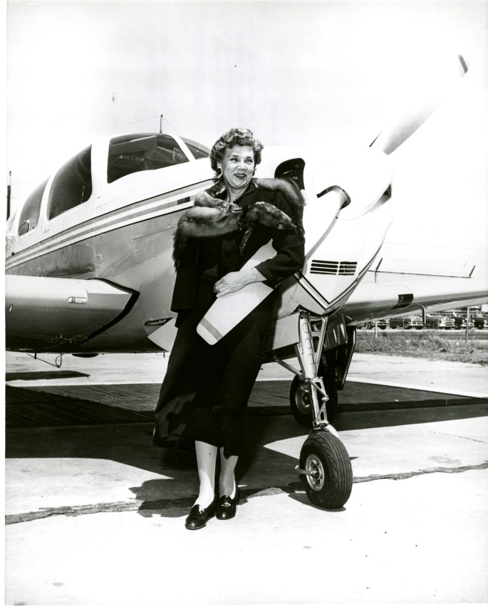 Blanch Wilcox stands by a plane.