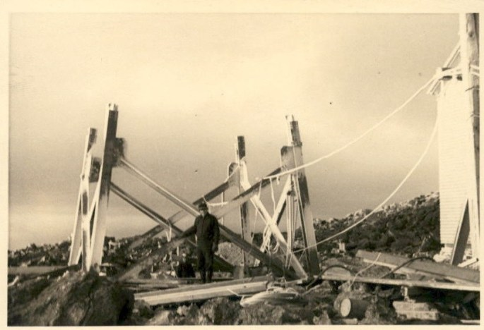 Image of Armstrong standing near a partially built tower.