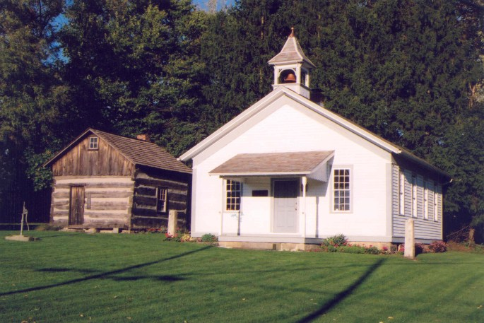 image of school house and cabin.