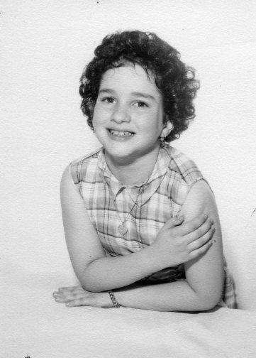 b&w photo portrait with her arms crossed