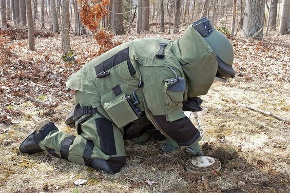 A Bomb Disposal Squad Officer performing his duty