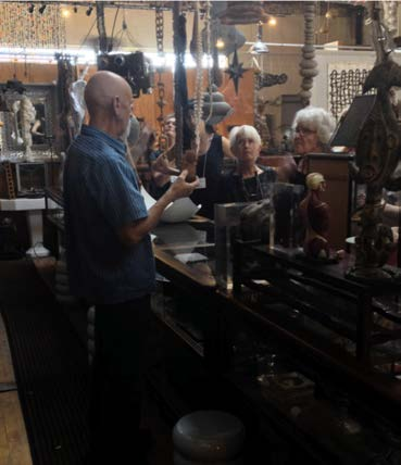 Graham explaining the history of some of his found objects to TSA members during studio tour