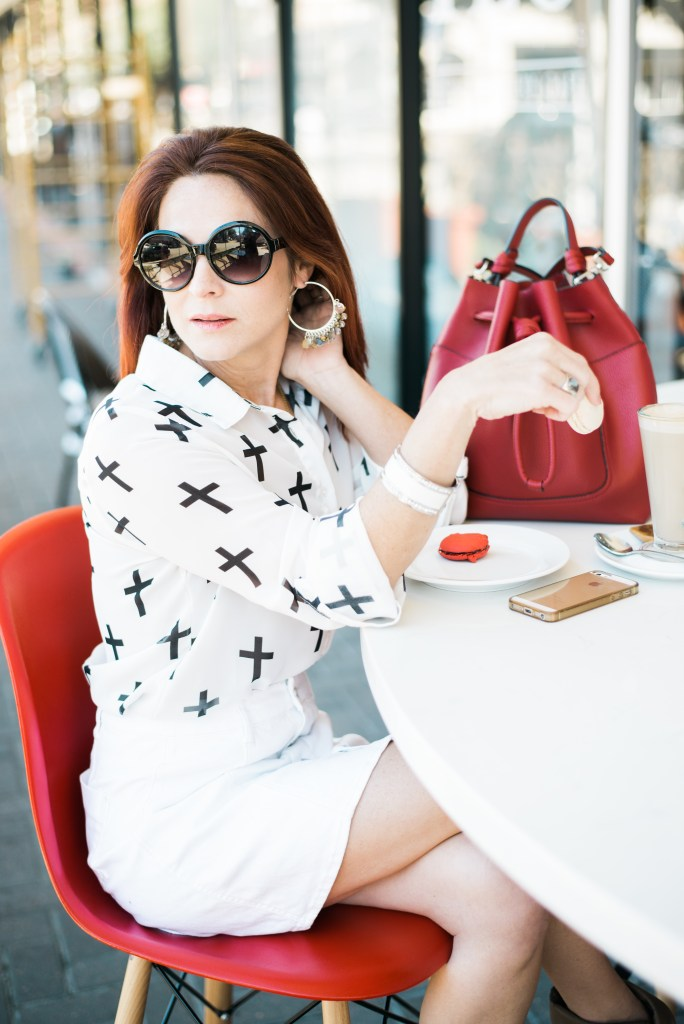 CROSS TOP, MACAROONS, BLACK SUNGLASSES, RED BAG