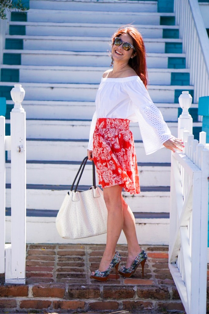 overcoming the heartache of special needs, special needs mom, red floral skirt, off the shoulder, dramatice sleeves, cheveron heels, white tote, galveston, texas