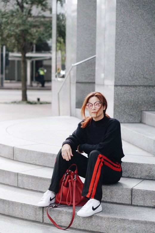 stying with track pants, chic street style, styling with white sneakers, red bucket bag, #whowhatwear #zara