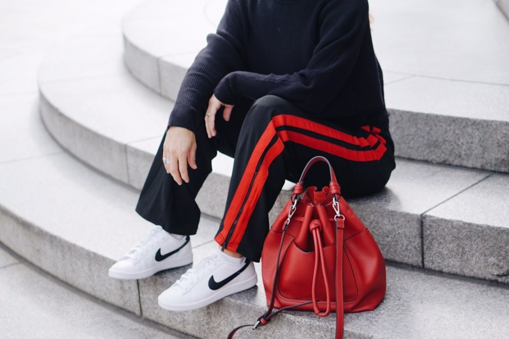 athletic style, athleisure, who what wear collection, nike sneakers, classic tennis shoes, red bucket back, black sweater, zara