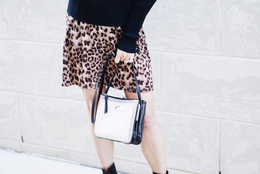 leopard skirt, black sweater, nine west bag, neutral bags,