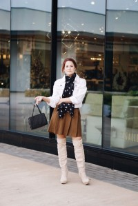 casual fall look, pleated skirts, styling with scarves, over the knee boots, small bags, white denim jacket outfits