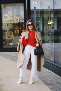 valentines day outfits, shawl collar duster coat, wool handbag, red sweater, white cropped flares, white boots, round sunnies
