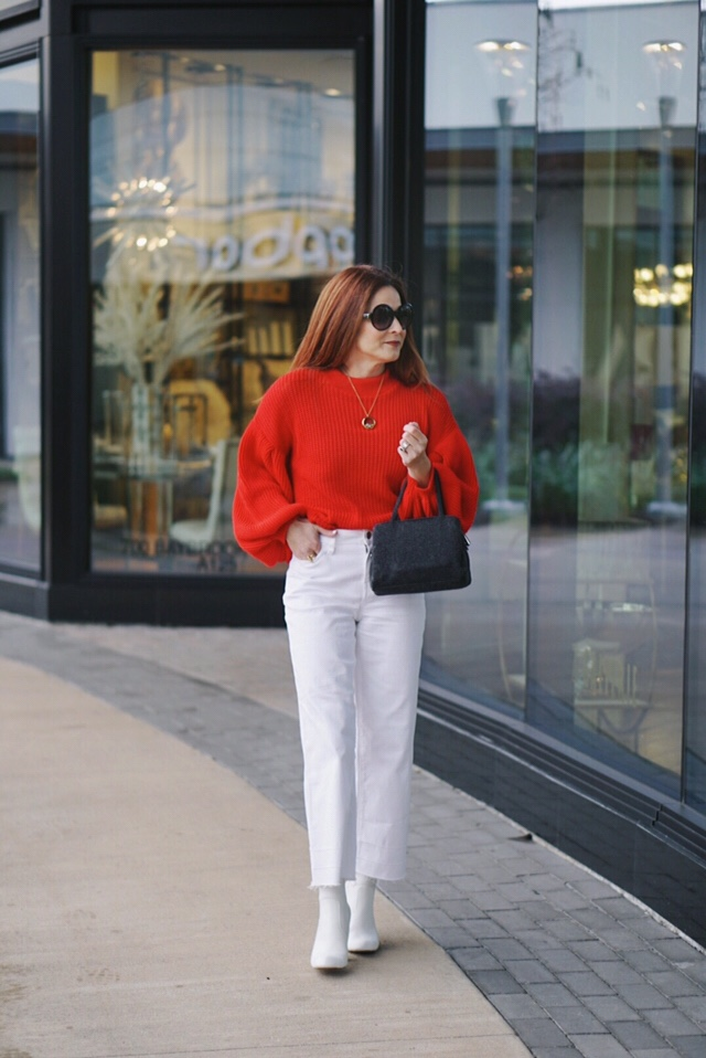 valentines outfit inspiration, high waisted cropped flares, white boots, grey bag, black round sunglasses