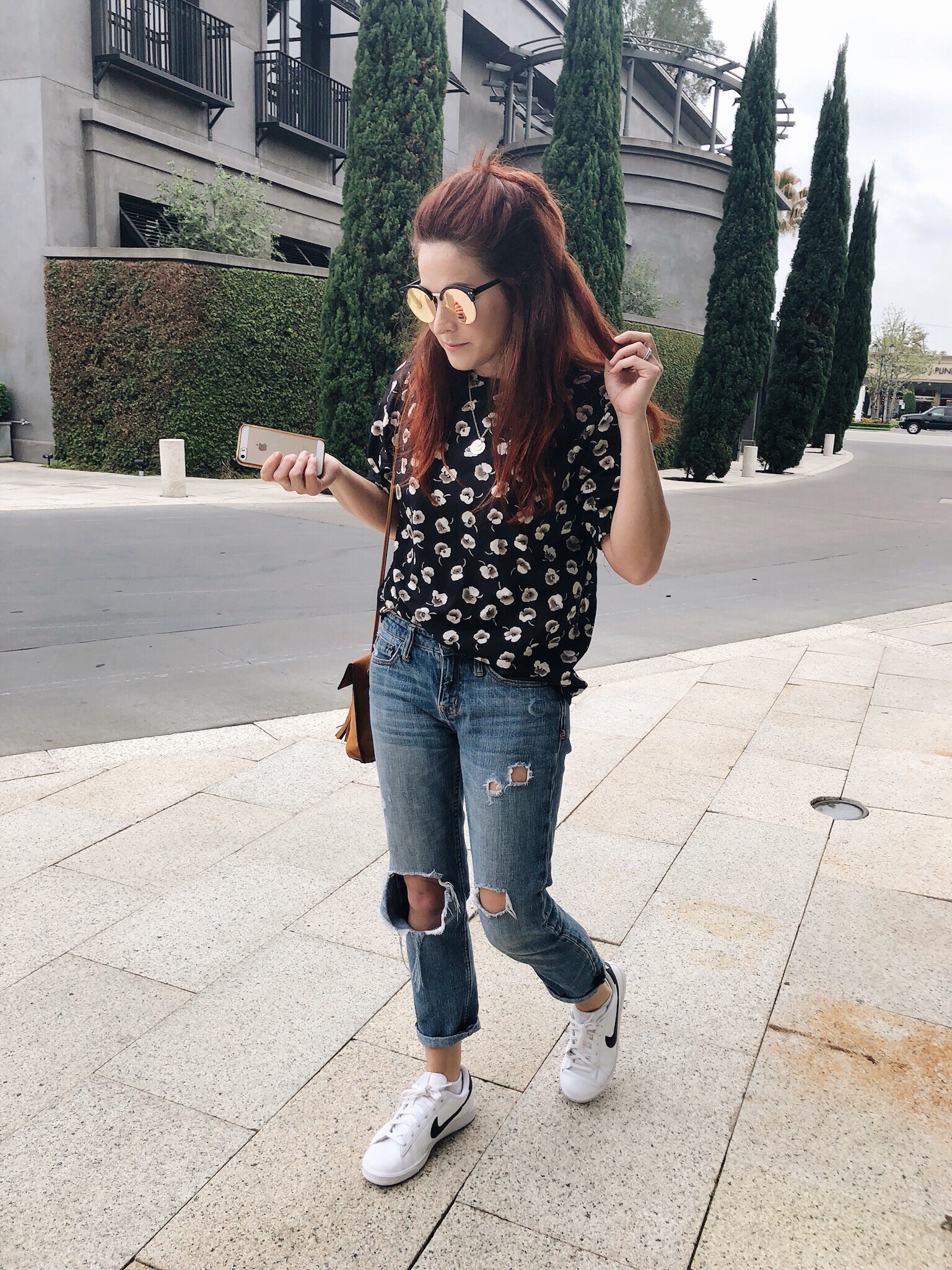casual photos, casual style, floral top, navy blouse with flowers, nike sneakers, mirror sunglasses