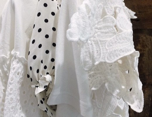 summer whites, mood board, inspiration, white garments, garments on a rack, white with black print, minimalist, neutral clothing