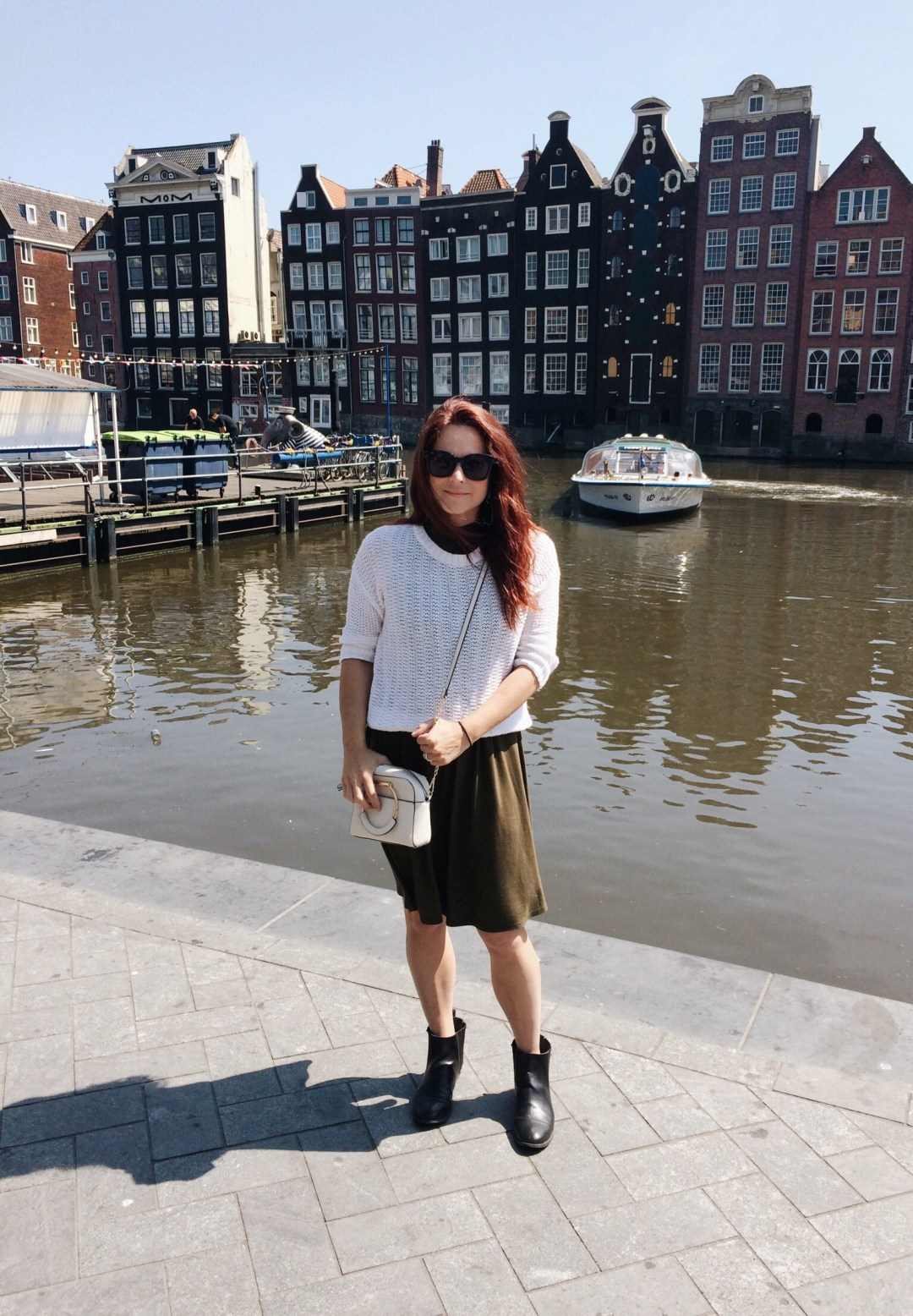 olive green swing dress, white sweater, chelsea boots, handle bar handbag, Amsterdam, Europe, vacation outfit ideas