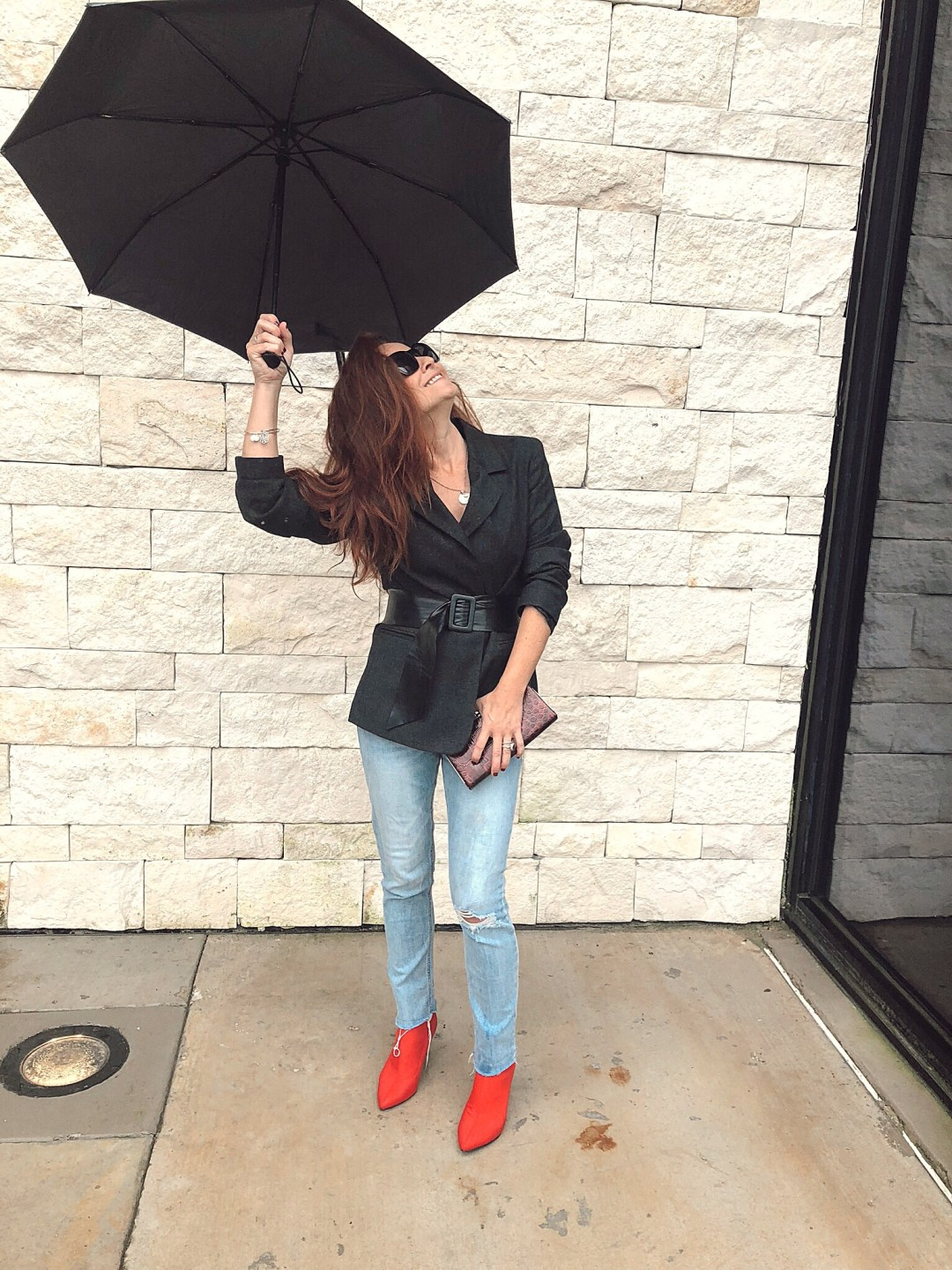 belted outerwear ideas, how to take photos when it's raining, red booties, blazer with jeans