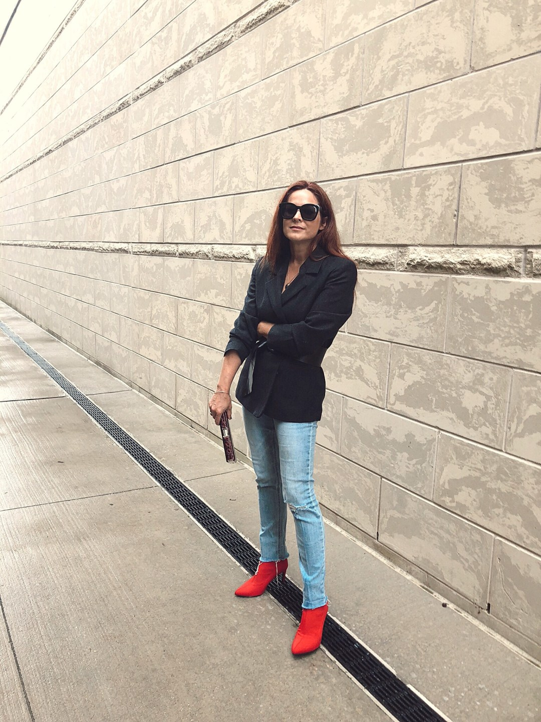 red boot outfit ideas, blazer and jeans outfits, red booties, sock booties, belted blazers