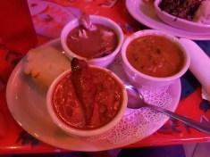 Oben Links: Krabbe, Darunter: Alligatorwurst und Red Beans, Rechts Gumbo