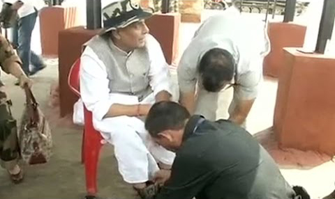 Home Minister shoelace tied to young