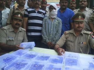 Checking the cache of weaponry found in Mughalsarai station