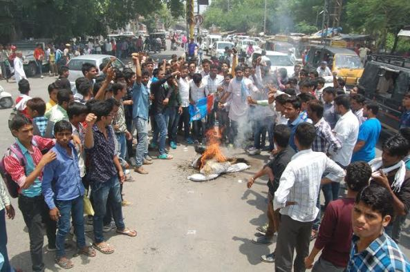 NSUI workers who blew the education minister's manikin