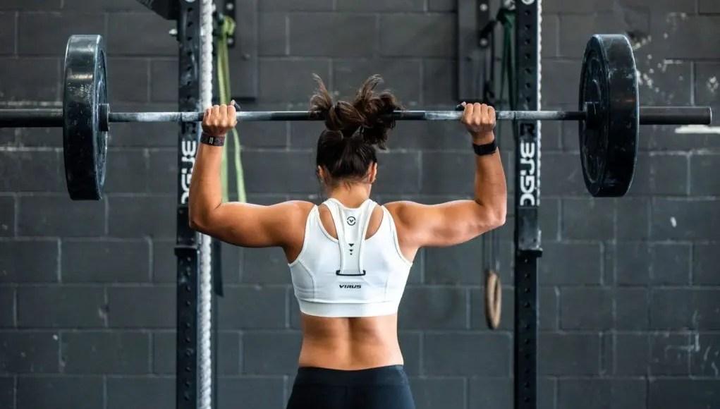 Woman Performing A Shoulder Press
