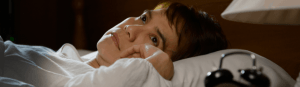 An image of a woman with insomnia and sleeping disorder