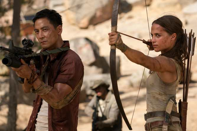 """DANIEL WU as Lu Ren and ALICIA VIKANDER as Lara Croft in Warner Bros. Pictures' and Metro-Goldwyn-Mayer Pictures' action adventure """"TOMB RAIDER,"""" a Warner Bros. Pictures release. Photo Credit: Ilze Kitshoff © 2018 WARNER BROS. ENTERTAINMENT INC. AND METRO-GOLDWYN-MAYER PICTURES INC."""