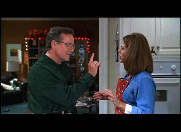 Phil Hartman and Rita Wilson in Jingle All the Way (1996)