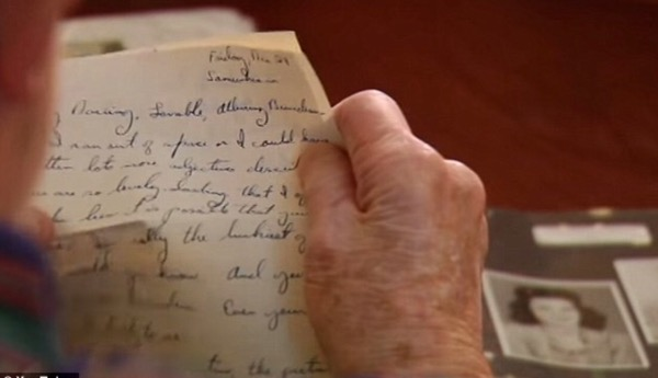 Bill Moore holding lost WWII love letter