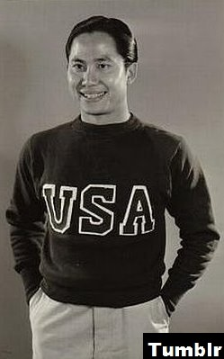 Chinese-American actor Keye Luke in a USA sweater