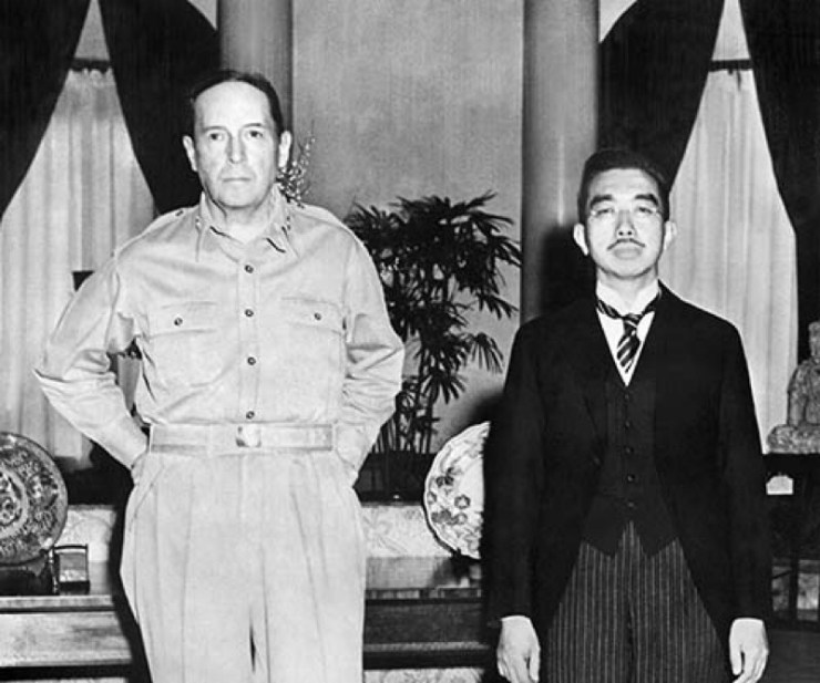 Famous image of Emperor Hirohito standing next to General MacArthur at their first meeting
