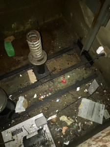 Trash accumulating in elevator pit