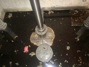 Water and oil inside of elevator pit