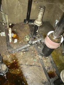 Elevator pit with debris scattered around
