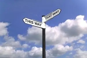 This Way That Way sign metaphor for contingency and retained executive search