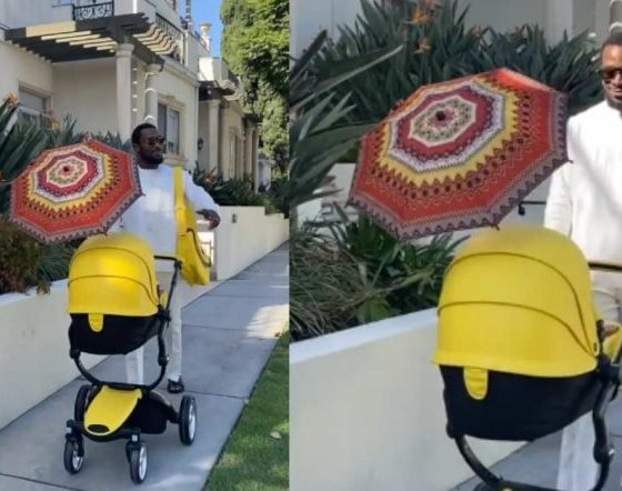 DBanj takes a stroll with his newborn, looking very happy (Video)