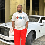 """Your Memories Lives On Forever LEGEND"" – Man Frames Hushpuppi's Photo To Hang In His room; Nigerians React (Photo)"