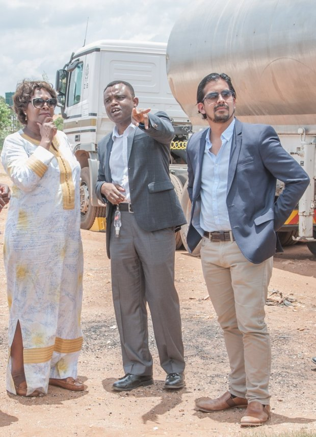 Hon. Margaret Mwanakatwe, Zambian Breweries country director Jose Moran and corporate affairs director Ezekiel Sekele deliver safe clean water to Bauleni.