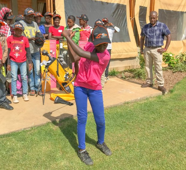 Young members of First Quantum Minerals' Kansanshi Development Club of Solwezi try out the golf kit received from Hitachi Construction Machinery Zambia.