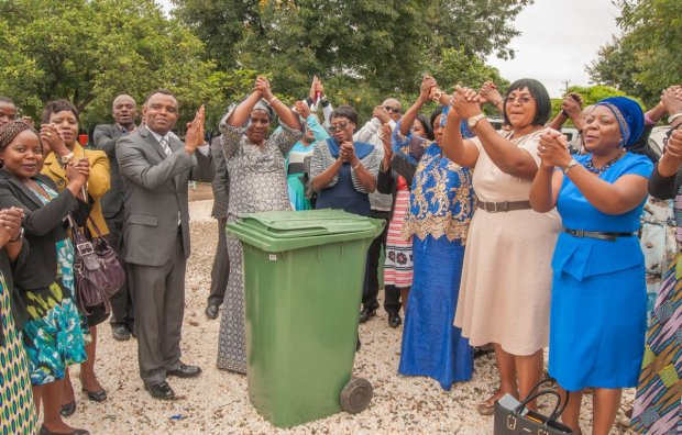 Ministry of General Education's director of human resources and administration, Peggy Chirwa and Zambian Breweries director of corporate affairs Ezekiel Sekele join representatives in handing over waste bins to schools in Kanyama.
