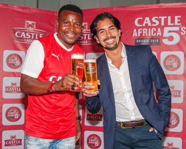Soccer legend Christopher Katongo celebrates the launch of the Castle 5s football league, with Zambian Breweries Country Director Jose Moran.