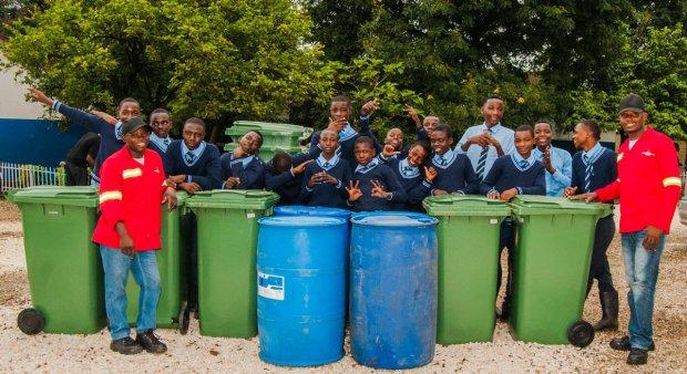 Pupils celebrate the donation of waste bins by Zambian Breweries' Manja Pamodzi initiative.
