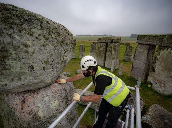 Conservator examines megalith at Stonehenge