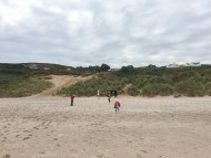 Hunting shells on the beach of Northern Ireland.