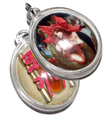 Mae Nang Dork Mai Flower Fairy Deva Locket, with double Takrut Hua Jai Maha Saneh, and a phial of concentrated ultra rare 'Nam Man Chamot'(civet oil) Sanaeh, and amulet embedded in rear face.