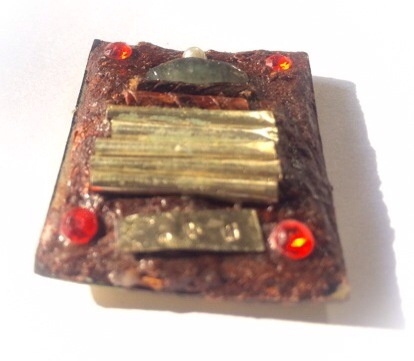 The rear face of the amulet is covered with Muan Sarn Sacred Powders, and has been stuffed full of Sacred Ploi Sek Maha Pokasap gems, and silver Takrut spells
