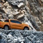 Nissan-NP300-Navara-12th-gen-rear-side-view-near-rocks
