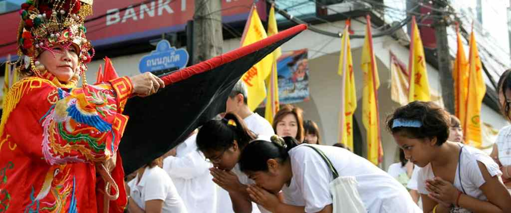Women praying during the Phuket Vegetarian Festival in Thailand. Thailand Event Guide. Events and Entertainment in Thailand.